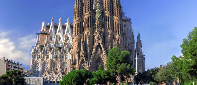 BARCELONA, SPAIN - OCTOBER 8: La Sagrada Familia - cathedral designed by Antonio Gaudi, view from the oldest facade at the morning, October 8, 2014 in Barcelona, Spain.